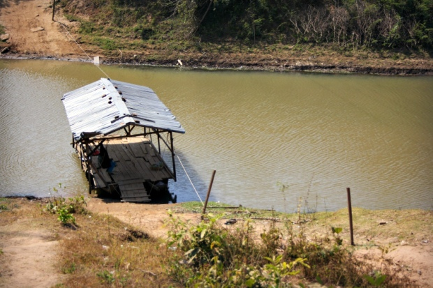 Small ferry at a sidearm of River Mekong