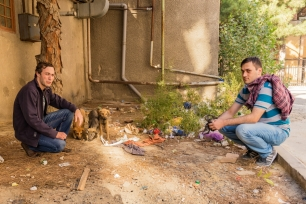 Davit (r) and his friend Sandro with street dog pups in Gldani